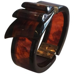 Rare Art Deco Black and Root beer bakelite ribbon hinged clamper bangle