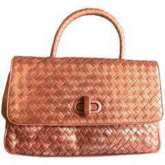Vintage Bottega Veneta intrecciato bronze lambskin bag with turn lock closure.