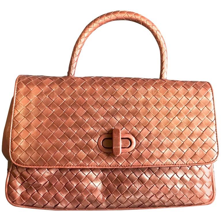 Vintage Bottega Veneta intrecciato bronze lambskin bag with turn lock closure.