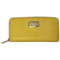 Michael Kors Leather Long Zipper Wallet in Yellow