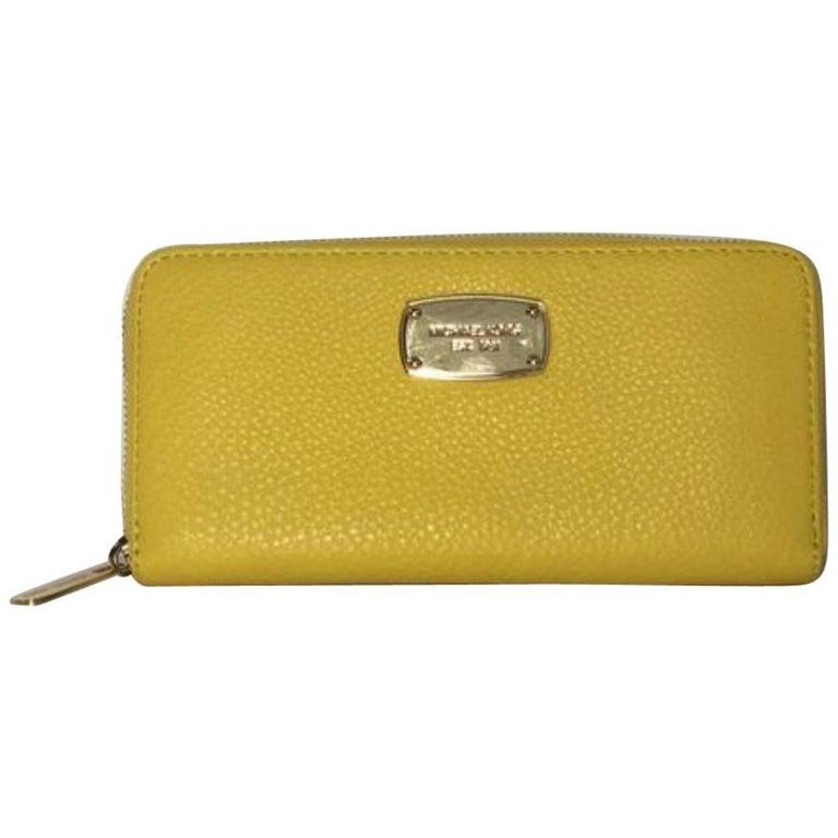 Michael Kors Leather Long Zipper Wallet in Yellow