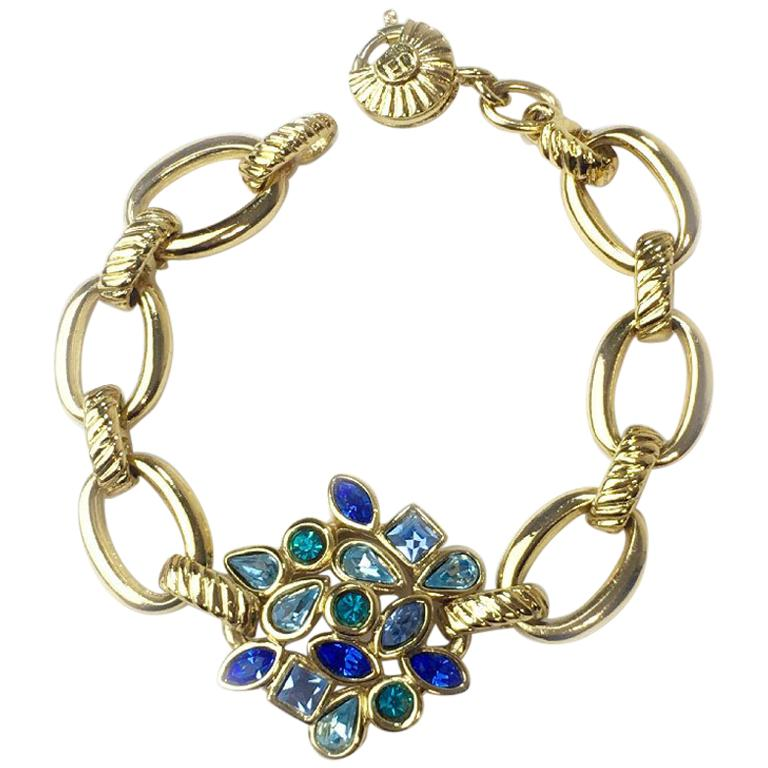 a7528dc10c7 YVES SAINT LAURENT Bracelet in Gilt Metal and Multicolored Rhinestones For  Sale