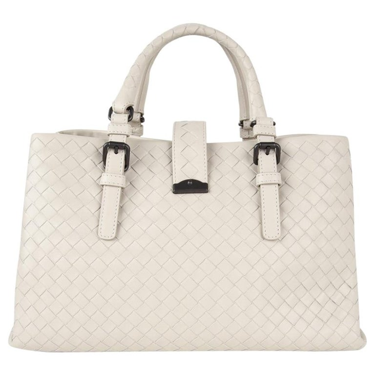 cb1904d53a Guaranteed authentic Bottega Veneta iconic intrecciato butter soft calf  leather tote shoulder small Roma bag.