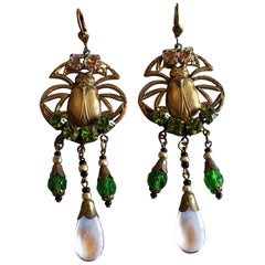 An Art Deco pair of Egyptian Revival brass earrings with Scarabs