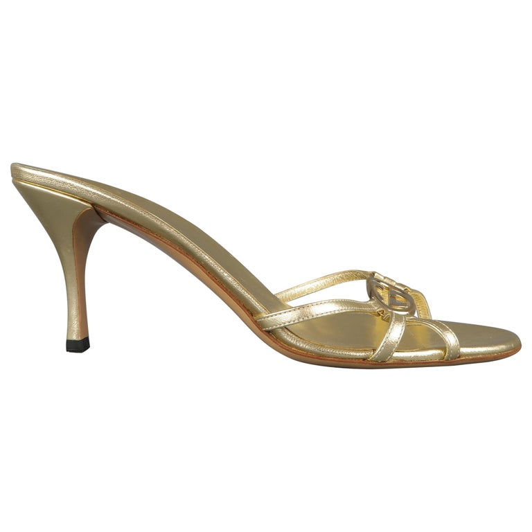 d83f7902d563a GUCCI Size 9 Metallic Gold Leather GG Monogram Strap Mule Sandals For Sale