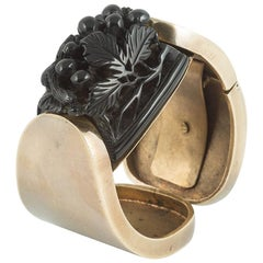 Black carved galalith, gilded metal clamper bangle and belt, French, 1930/40s.