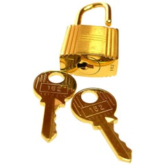 Hermès Cadenas Lock 2 Keys For Birkin or Kelly bag Gold plated shiny and brushed