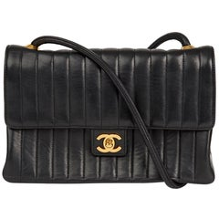 1980s Chanel Black Vertical Quilted Lambskin Vintage Classic Single Flap Bag