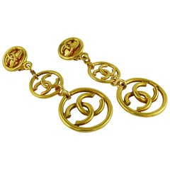 Chanel Vintage Gold Toned Three Tiered CC Dangling Earrings, 1993