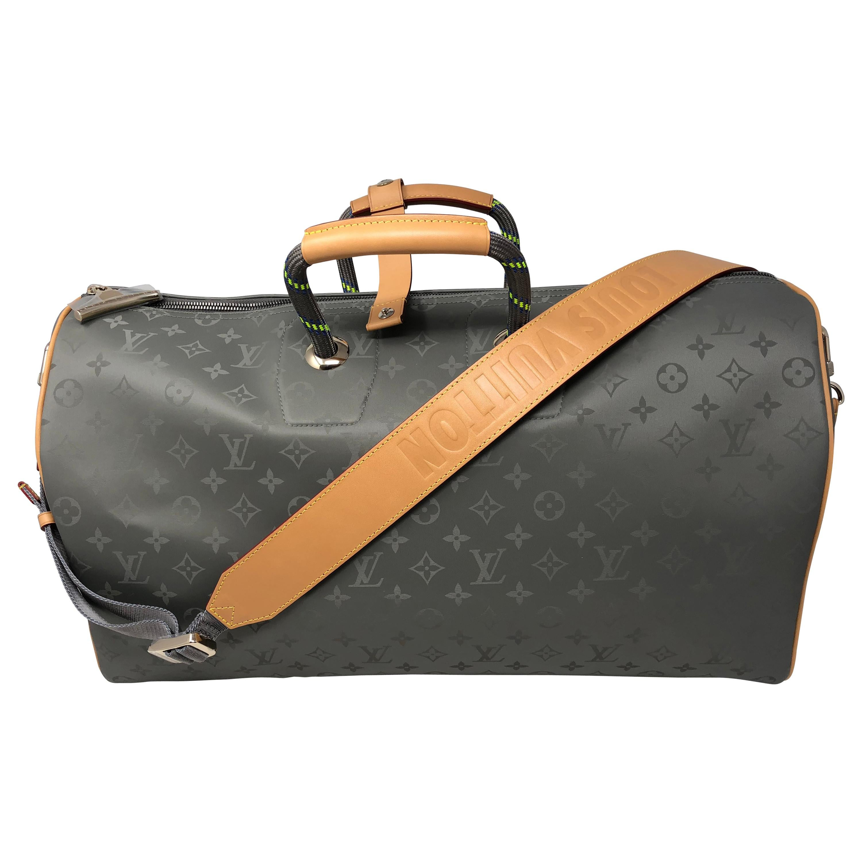 6134ed530f16 Louis Vuitton Titanium 50 Grey Keepall Bandouliere at 1stdibs