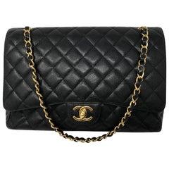 Chanel Maxi Black Caviar GHW Double Flap