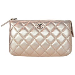 Chanel Pink Rose gold Metallic Lambskin Leather Quilted Cosmetic Pouch Bag