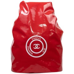 CHANEL Waterproof Red Laminated Canvas Backpack