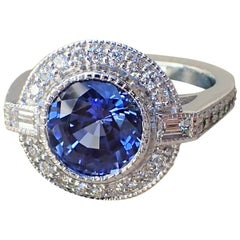 18k White Gold Ring with 3.93 carat Chatham Sapphire and 0.61 carats of Diamond