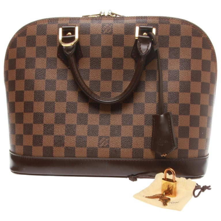 Louis Vuitton Alma PM Handbag with key clochette For Sale at 1stdibs fe6582aaeb