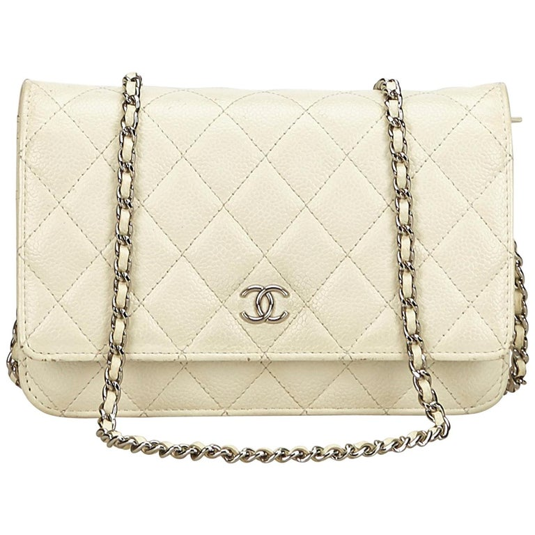 65c4d19a7fdfc0 Chanel White / Ivory Quilted Caviar Wallet On Chain For Sale. The WOC  features a quilted leather ...