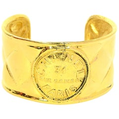 Chanel, 90's, Goldtone Quilted Cuff Bracelet w/ Center Logo