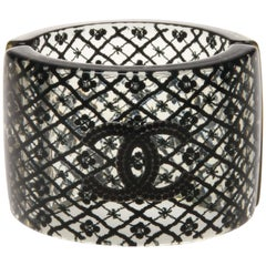 Chanel large black floral / pearl cuff with black CC logo