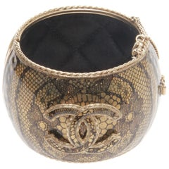 Chanel Iconic CC Flora Lace Patterned enamel cuff bracelet
