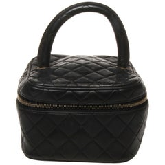 Chanel black quilted makeup case