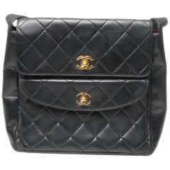 Chanel black handbag with double pockets