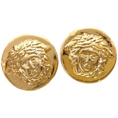 Vintage Gianni Versace golden round medusa motif earrings. Lady Gaga style.