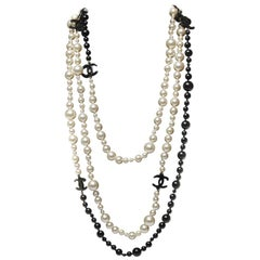 Chanel Black and pearl long triple chain with CC logos in black