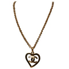 Chanel heart shaped pendant with CC logo