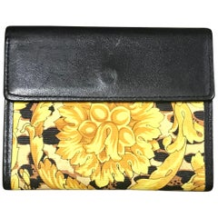 Gianni Versace Vintage black card case wallet with yellow arabesque and leopard