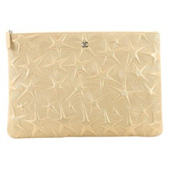 Chanel O Case Clutch Star Embossed Lambskin Large
