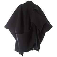 Comme des Garcons black wool coat constructed from large woven panels, AW 1983