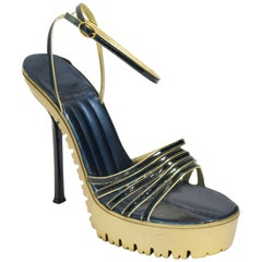 Yves Saint Laurent Gold and Black Combat Tread Platform Heels 9.5