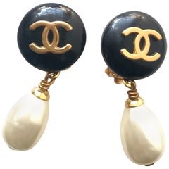 Vintage CHANEL teardrop white faux pearl earrings with black and golden CC mark