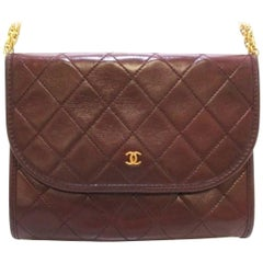 Vintage CHANEL brown 2.55 style mini shoulder bag with CC and skinny chains.