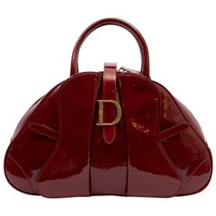 CHRISTIAN DIOR Saddle Bag in Red Patent Monogram Leather