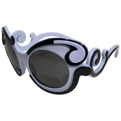 e6b881f834 Prada Minimal Baroque Swirl Sunglasses Italy Periwinkle Great for Easter