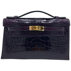 Hermes Aubergine Mini Kelly Pochette in shiny crocodile