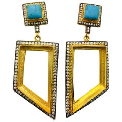 Meghna Jewels Turquoise Abstract Hand brushed Hollow Earrings