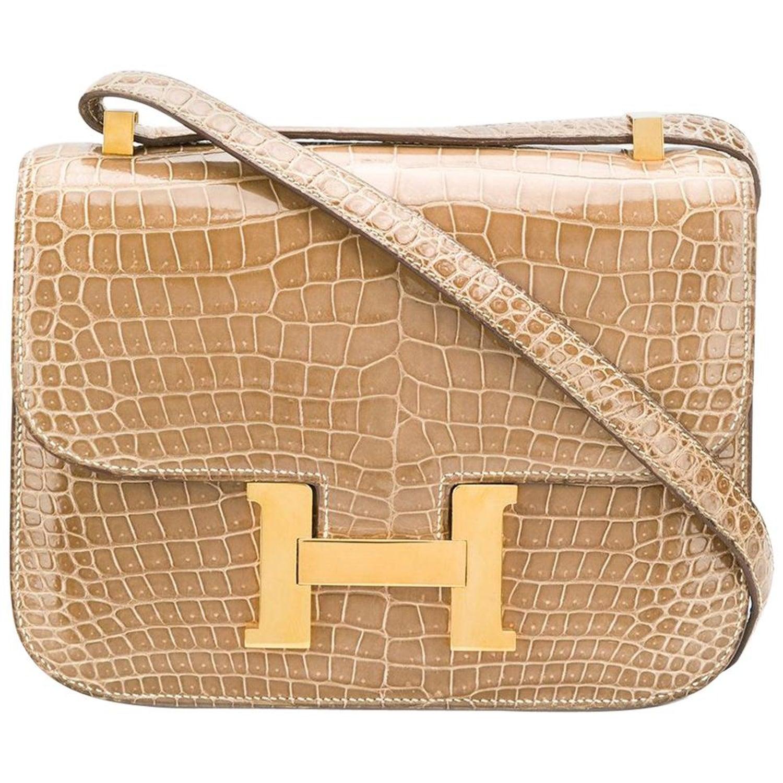 e48812af94ff Hermès 23cm Poussiere Crocodile Constance Bag at 1stdibs