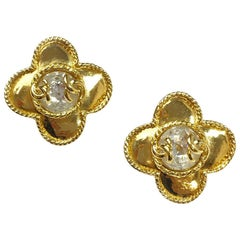 CHANEL Clip-on Earrings in Gilt Metal set with a Large Rhinestone