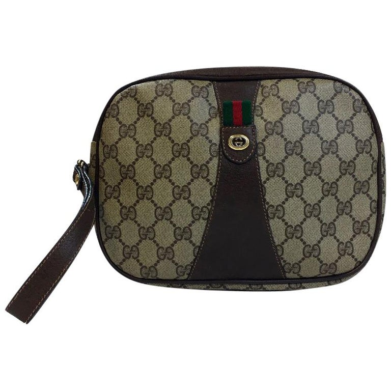 3902baeb48e7 GUCCI Clutch Bag in Beige Monogram Coated Canvas and Brown Leather For Sale