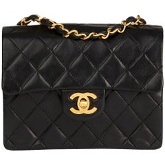 1986 Chanel Black Quilted Lambskin Vintage Mini Flap Bag