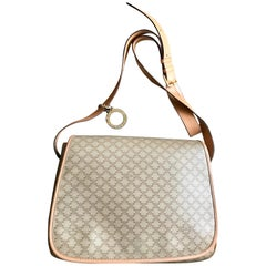 Vintage Celine beige macadam blaison pattern messenger bag with gold tone charm.