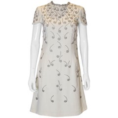 A vintage 1960s cream silver beaded music note A line shift party dress