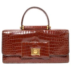 1940's HERMES crocodile top handle bag with geometric hardware