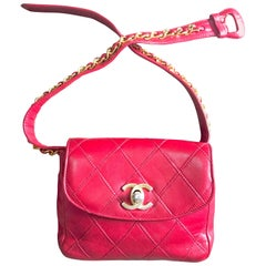 Vintage CHANEL 2.55 red calf belt bag, fanny pack with golden CC closure. Rare.