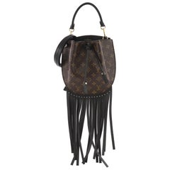 Louis Vuitton Fringed Noe Monogram Canvas with Leather