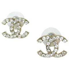 CHANEL CC Stud Earrings in Gilt Metal and Rhinestones