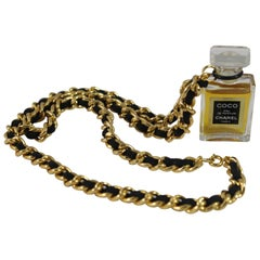Chanel Vintage Necklace with Chanel parfum Bottle.