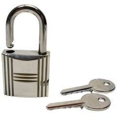 Hermès Cadenas Lock & 2 Keys HAC bag Palladium Finish/ Excellente Condition